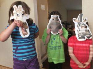 Kids Wearing their Madagascar Face Masks